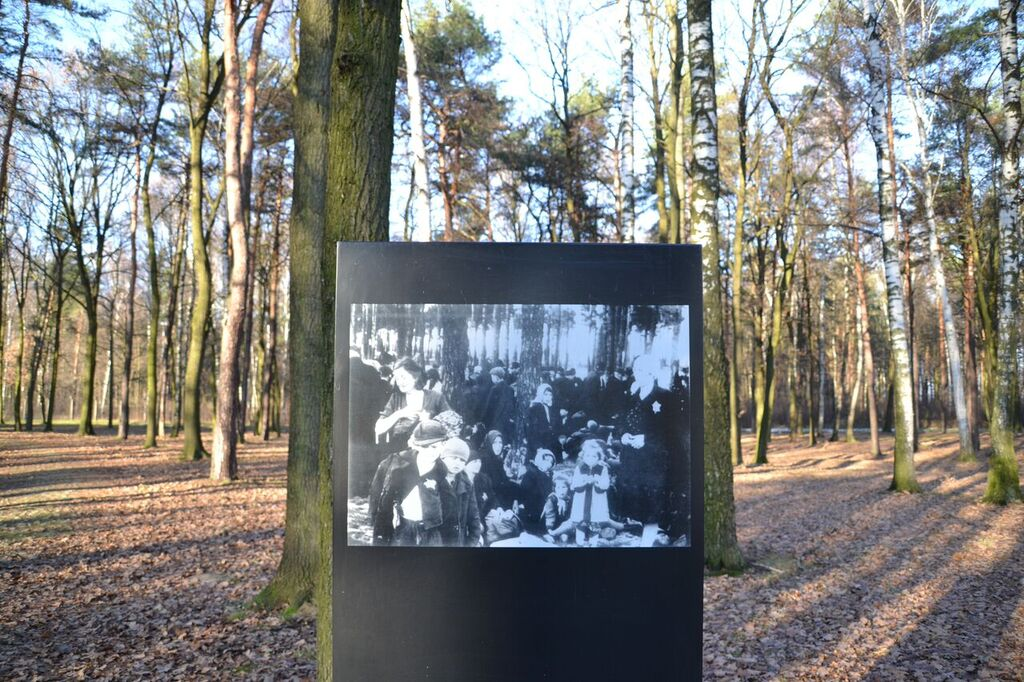 Photograph of women and children waiting for their turn in the gas chambers. The tours do not come this far into the camp s both days, I did not bump into anyone near the chambers & woods. It was incredibly emotional and for me, the hardest part of the experience to stand where these photographs were taken.