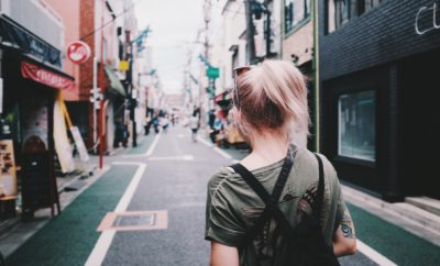 A girl walking down a street on her travels around the world