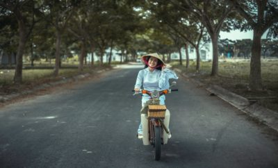 Girl cycling in Chiang Mai