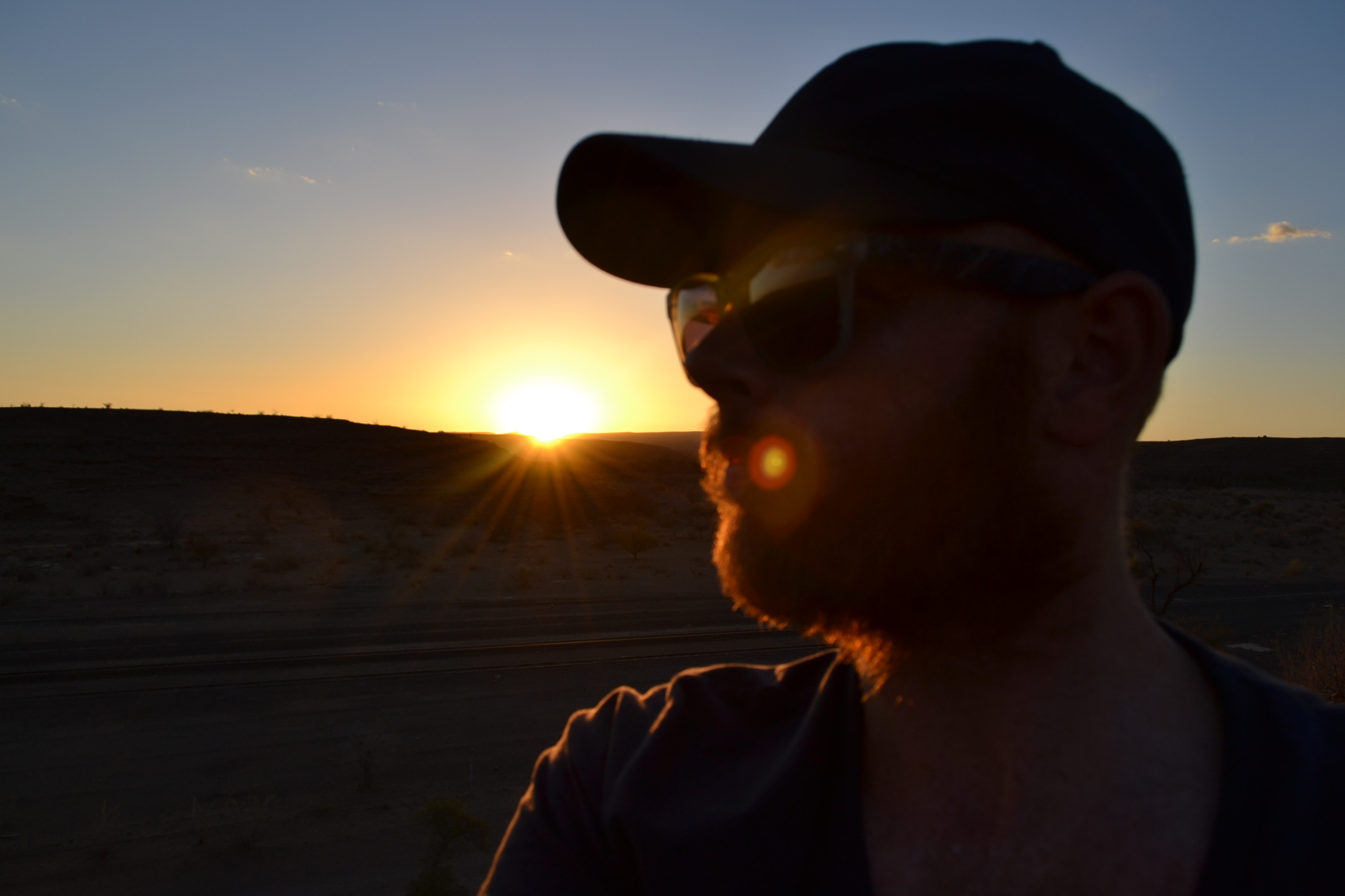 Sunset, the coolest pic of me I could find!
